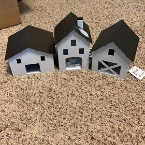 Three lighted houses New
